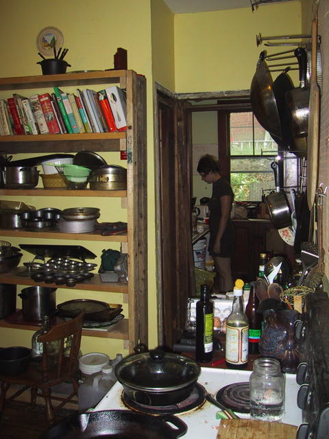 the forbes kitchen with plaster walls and shelves full of stuff