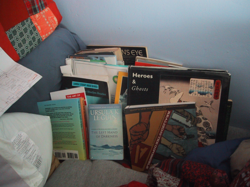 pile of books in bed!