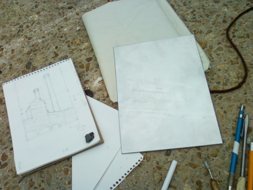 preliminary pencil drawing and metal plate with tools…