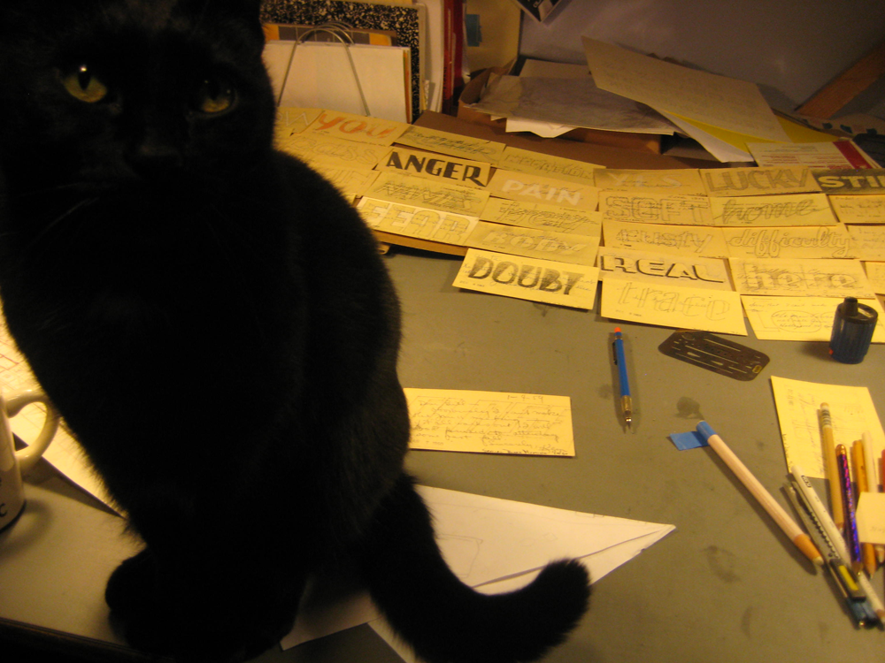 "cat on desk ""helping"" with art"