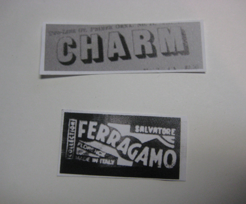 "two words, ""charm"" and ""ferragamo"", in old typefaces"