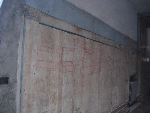 red chalk drawings on an interior building wall