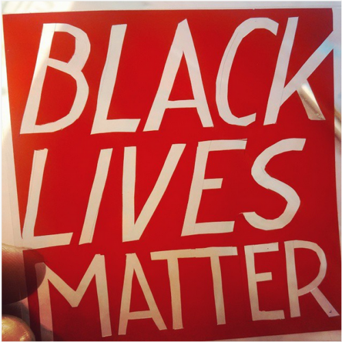 large letters in red and white that say: BLACK LIVES MATTER