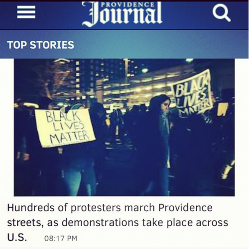 screenshot of the Providence Journal website showing a photograph of protestors holding Black Lives Matter signs